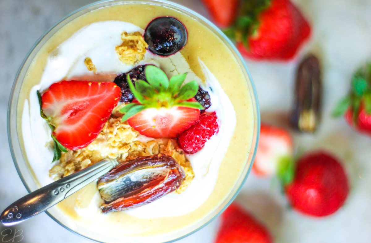 a berry parfait with tigernut-sweet potato yogurt, berries, dates, granola and coconut cream