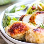 side view of plate served with salad and maple rosemary chicken