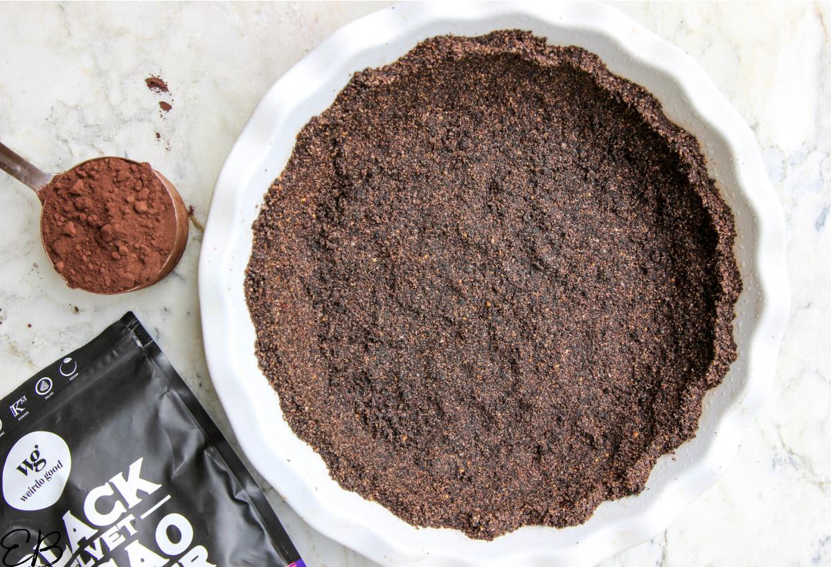 overhead view of black velvet cacao powder and oreo pie crust