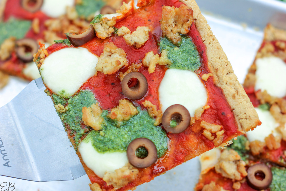 a piece of paleo & aip pizza on a spatula