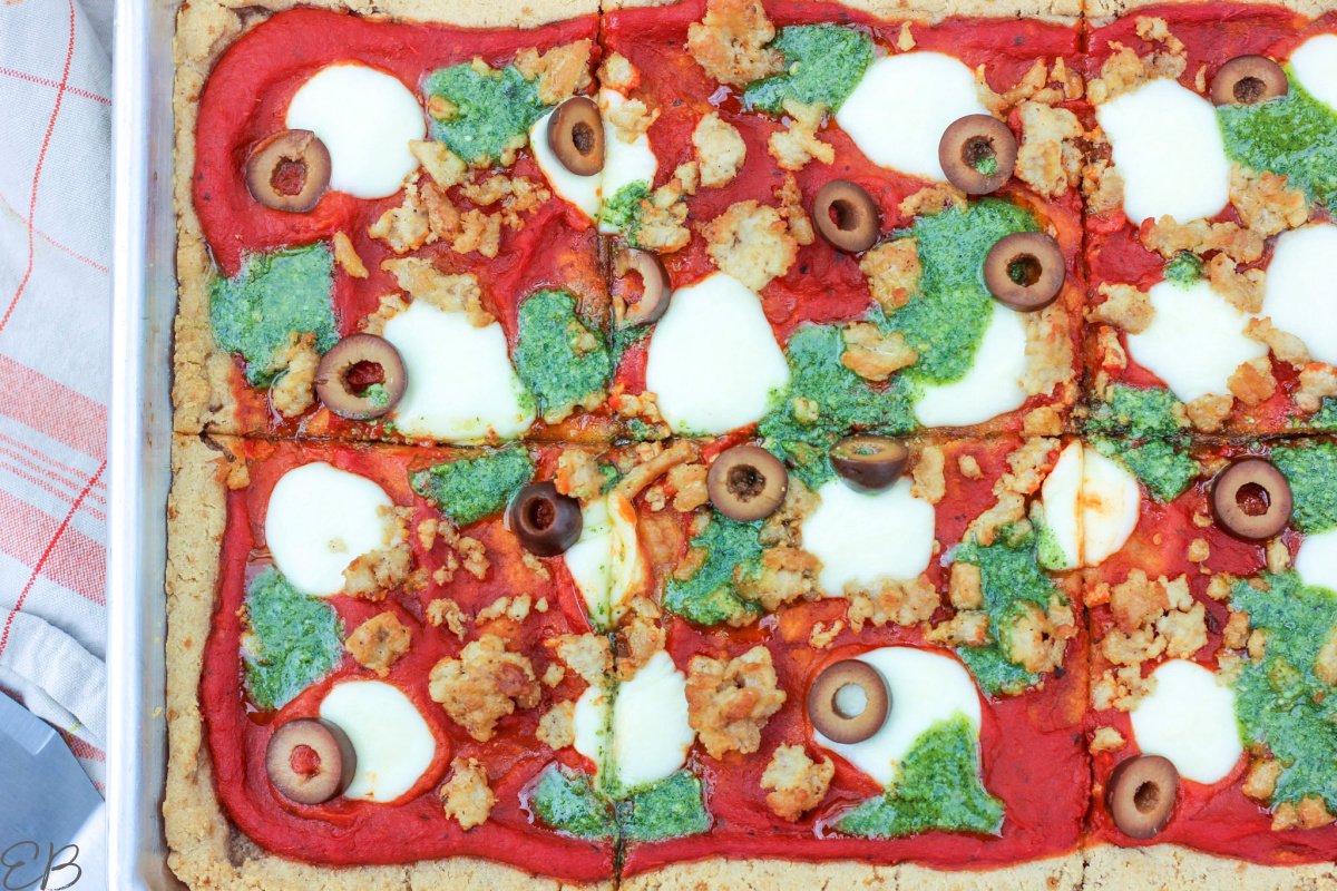 overhead view of entire AIP pizza with toppings, cut into sections