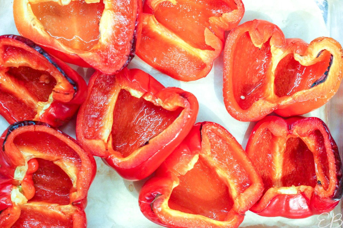 overhead view of freshly roasted red bell peppers before being stuffed
