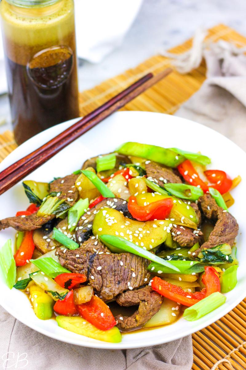 a steak stir fry with teriyaki sauce in the background
