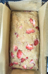 overhead view of strawberry keto vegan bread in loaf pan before being baked