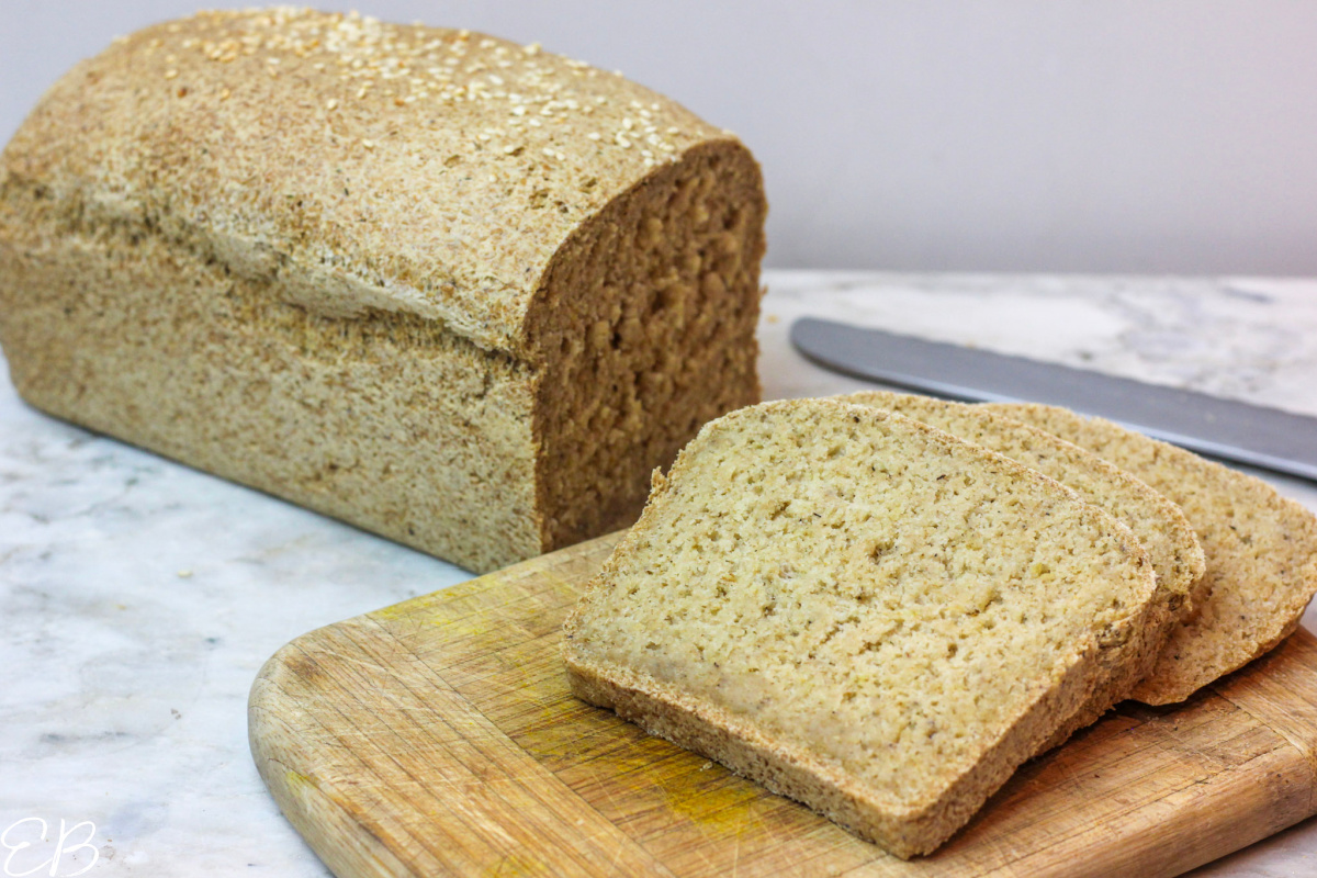 whole loaf of gluten-free vegan oat bread with 3 slices cut off