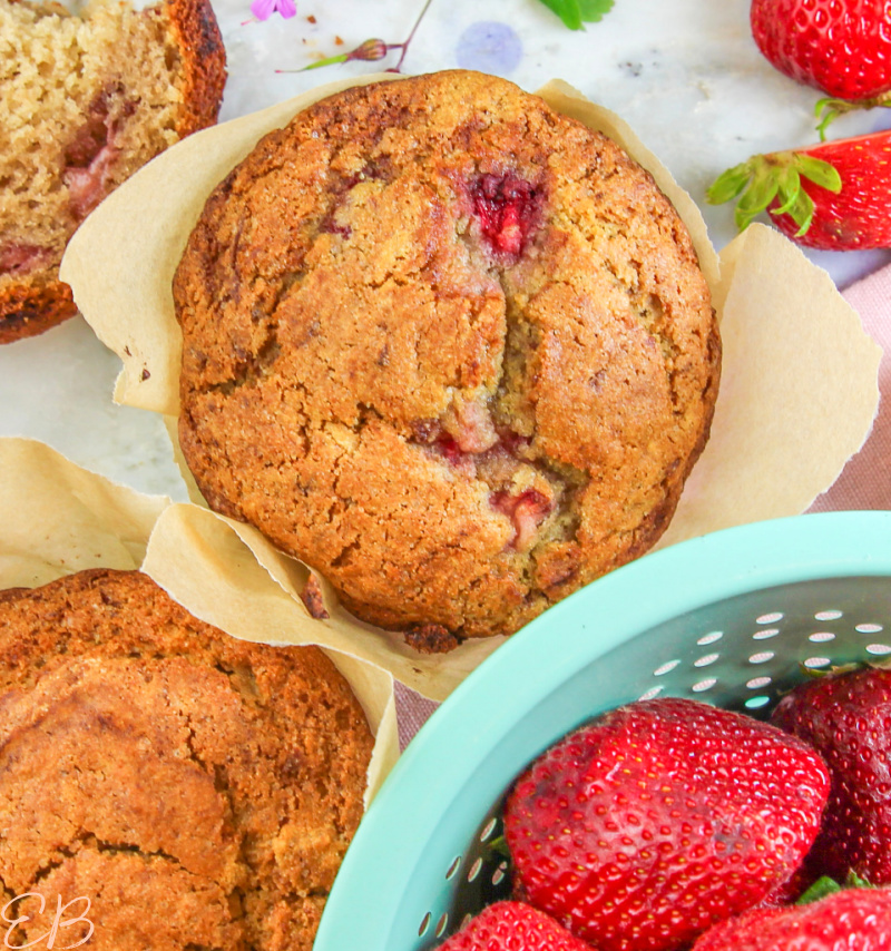 a close-up overhead view of one paleo strawberry muffin