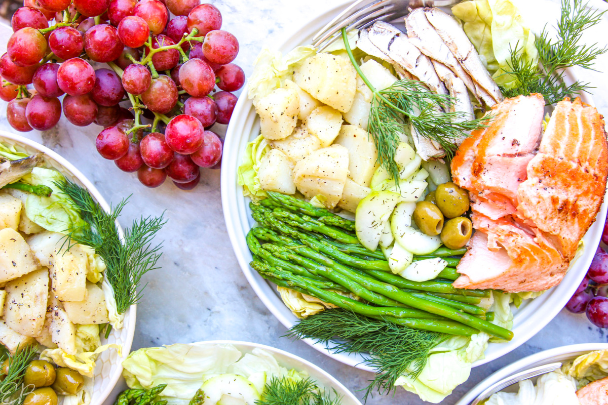 overhead view of salade nicoise and grapes