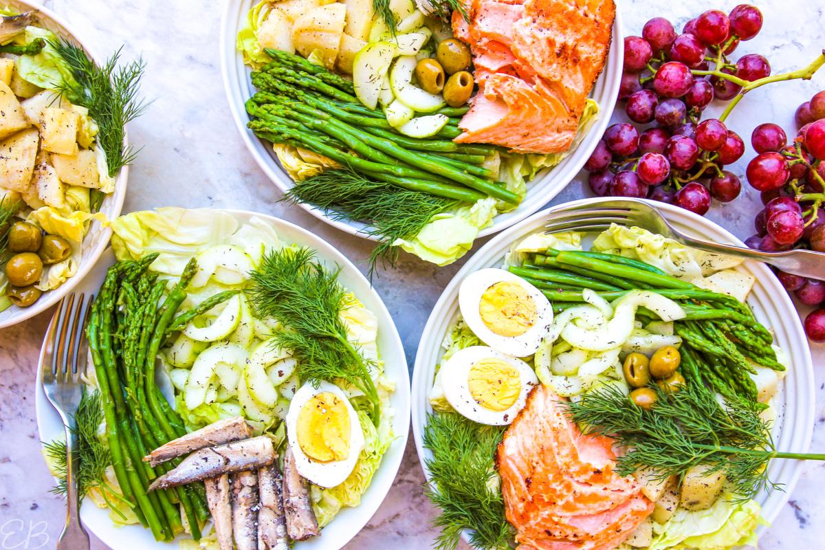 overhead view of 4 salade nicoise salads