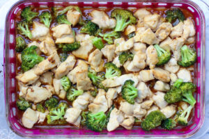 process photo after chicken and broccoli have baked in casserole dish with sauce