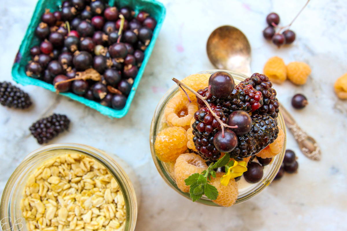 overhead view of oats jar topped with fruit