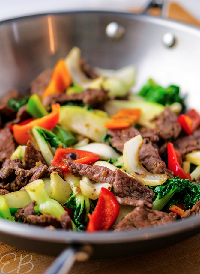a wok with steak stir fry