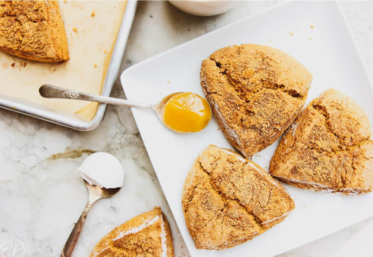 overhead view of aip pumpkin scones and spoon with honey