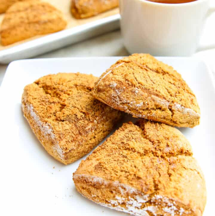 3 aip pumpkin scones on a white plate