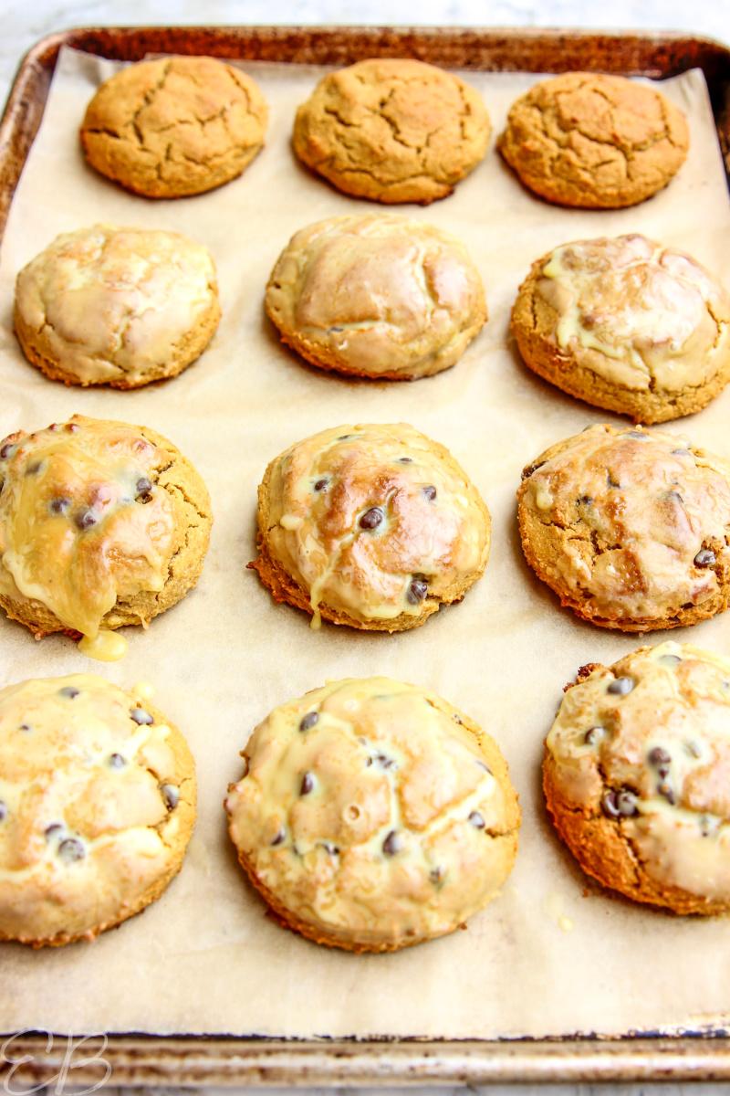 side angle of 12 Paleo Pumpkin Scones on baking sheet