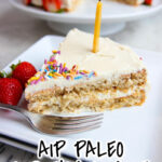 one slice of AIP Birthday Cake with lit candle