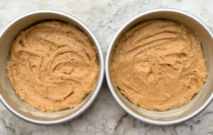 cake batter in pans before baking process photo