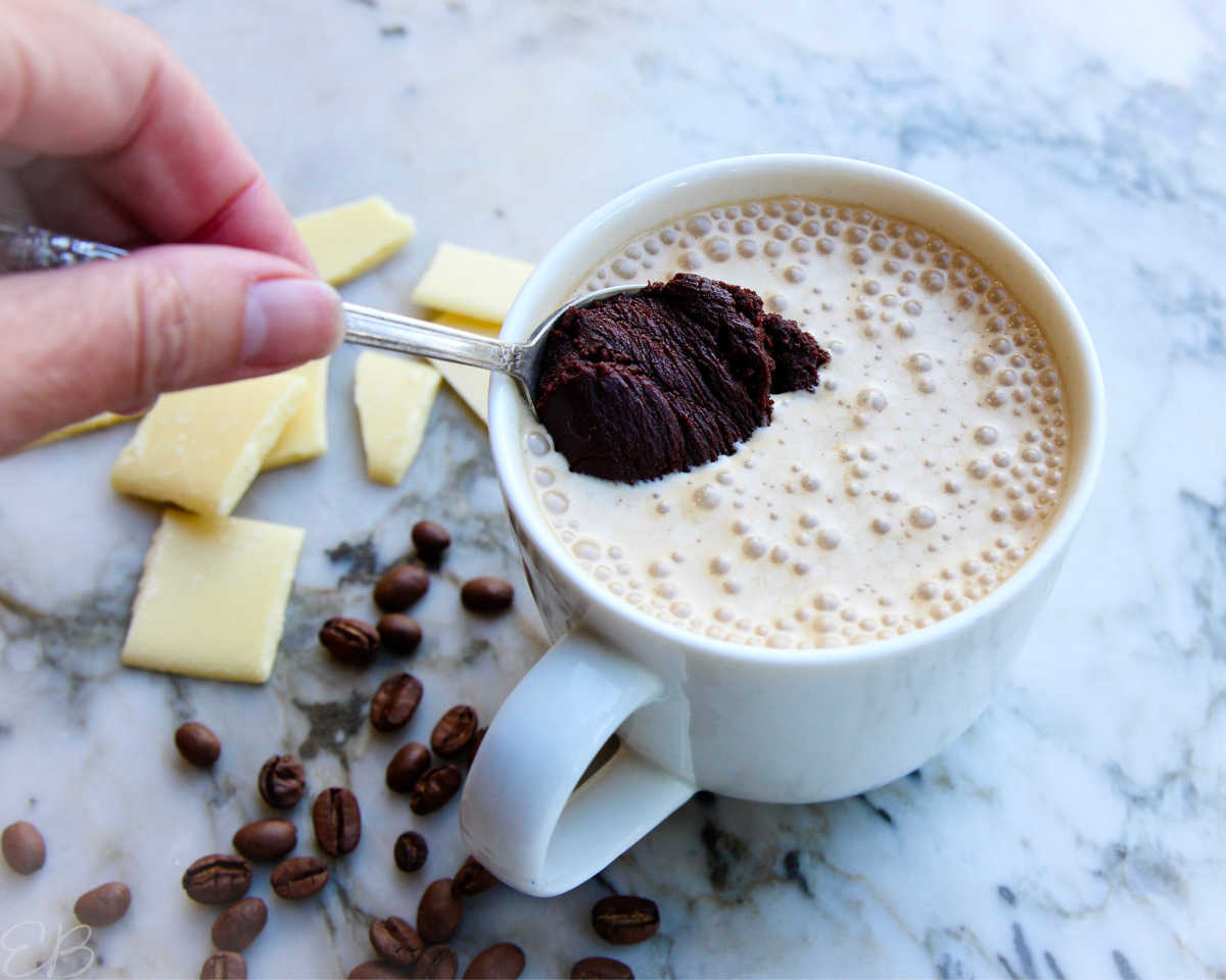stirring a spoonful of ganache into cocoa butter bulletproof coffee