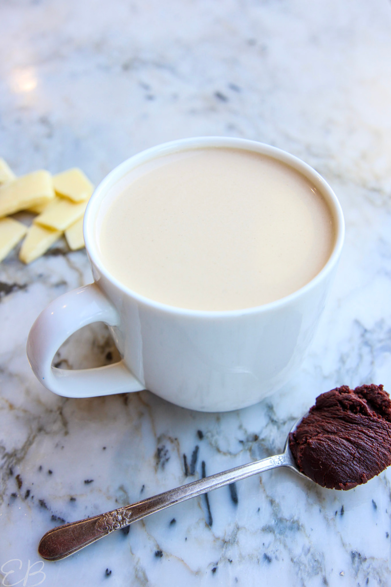 a white mug filled with cocoa butter bulletproof coffee