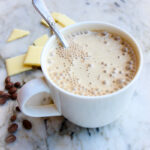 angled photos of cocoa butter bulletproof coffee with cocoa beans