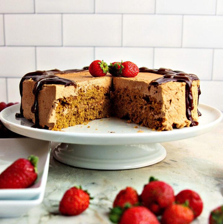 Oat Flour Cake on white cake stand near window
