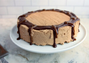 simply decorated oat flour cake with chocolate whipped cream