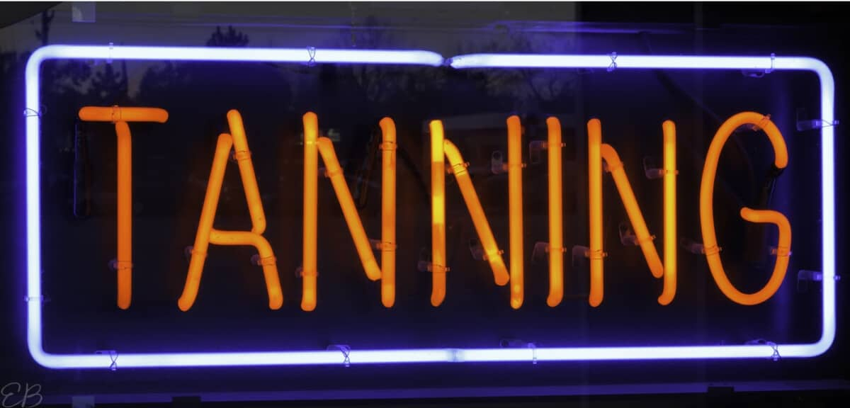 a neon tanning sign